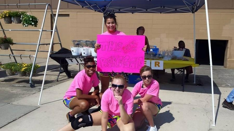 Tonyce Jackson, Brittnee Beccue, Perry Bailey and Kensley Ortega are trying to raise funds for Sugar Bowl performance by holding a bake sale at a local Walmart.