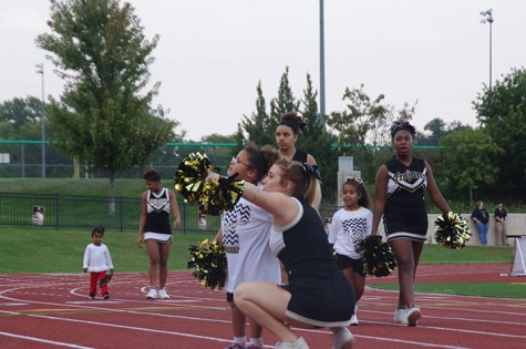 Kennedy Robinson, sophomore cheerleader, points the crowd out to a kid from the clinic