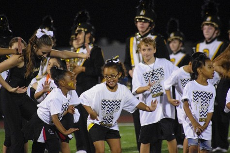 "The kids perform ""Shake it Off"" at half time of the game"