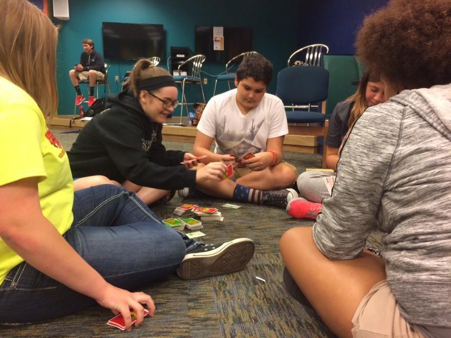 During a break, StuGo members play Apples to Apples.