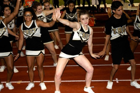 "Jillian Murphy, senior, ""hits the quan"" during the halftime show."
