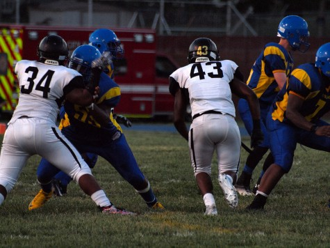 Kevon Seats, senior (34), and Brian Collins (43), senior, getting into the backfield.