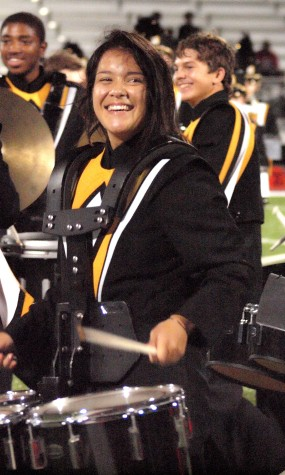Simone Cruz, junior, performing with a smile on her face for the Topeka High School Drumline.