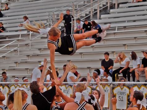 Stevianna Lorson, senior, and other cheerleaders practicing stunts before the start of Thursday night's game.