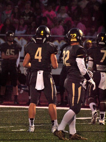 Jacob Anderson (4) and Brady Packard (32), senior, checking to the sideline for the defensive play call. Packard had 3.0 sacks on the night.