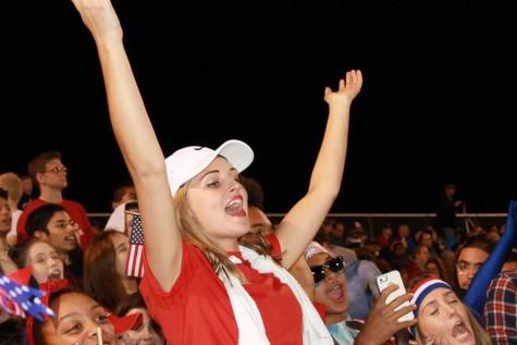 Bella Dickeson, senior, celebrates a late Trojan score.