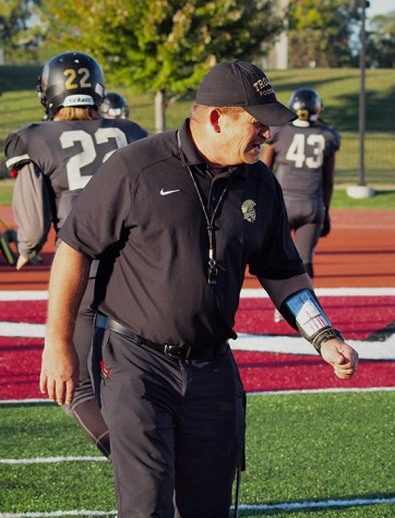 Topeka High head coach, Walt Alexander getting his players ready before the game.
