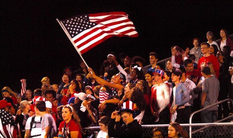 Matthew Gonzales, senior, waves an American flag to celebrate a 34-10 win over Washburn Rural, which puts Topeka High at 8-0 on the season.