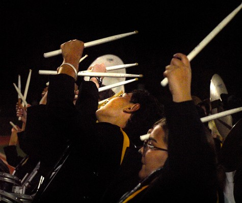 The Topeka High School Drumline performing for the student section during the halftime show.