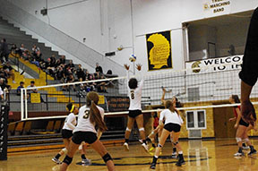 Halla Whitlock, 8, goes up to block the ball above the net.
