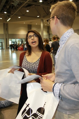 Jessica Barriga and Matthew Gatschet, seniors, take in their day as things come to a wrap at the College & Career Fair and the Kansas Expocenter.