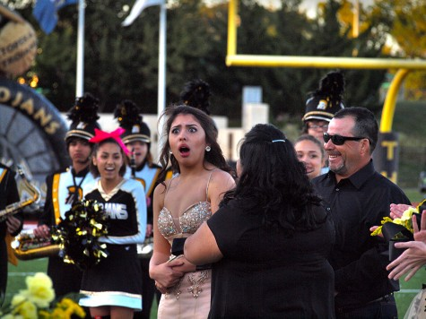Jessica Barriga, senior, reacts as she is crowned Topeka High's 2015 Homecoming Queen.