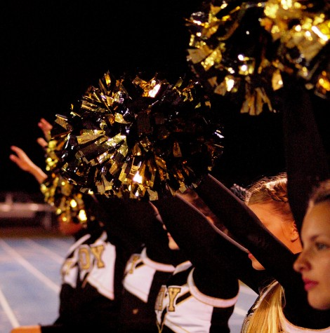 The Trojan Cheer Team shakes their pom-poms in anticipation of a kickoff.
