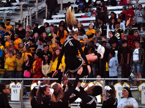 Stevianna Lorson, senior, practices a stunt before the senior night game against Manhattan Friday night.