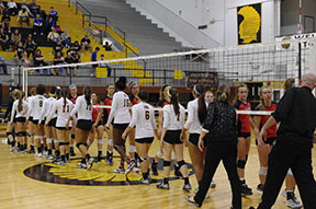 Topeka High Volleyball team claps hands with the opposing team, Blue Valley West, after the 3rd match of the first game.