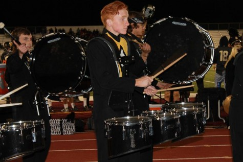 Connor Champney, junior, plays the quad drums for the Topeka High School Drum Line's performance in front of the student section on Friday Night.