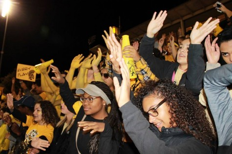 "The Topeka High student section ""stands up and leans"" to a cheer Friday night."