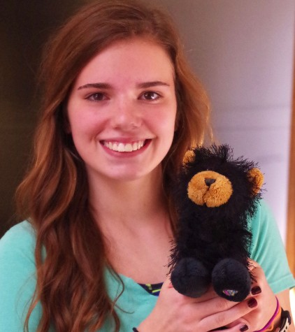 Tori Vaughn, junior, posing with her bear.