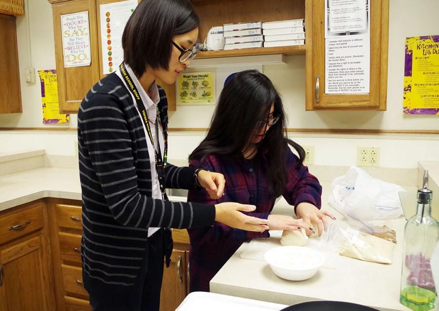 Vogel and Mena, forming pancake dough.