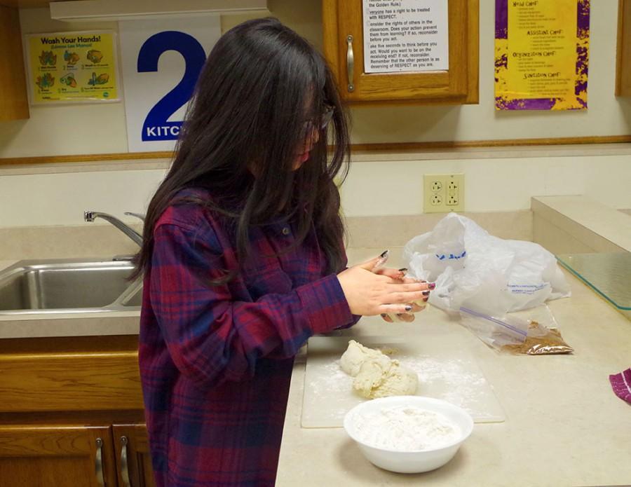 Alma Mena, junior, making traditional Chinese pancakes.