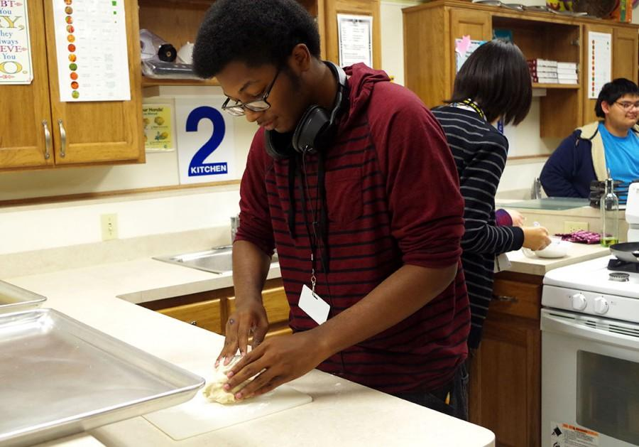 Parker making more pancake dough.