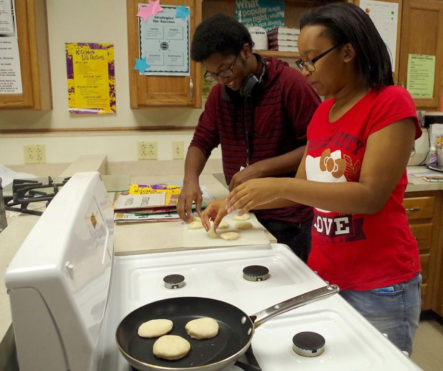 Parker and Olivia Watson, freshman frying their pancakes.