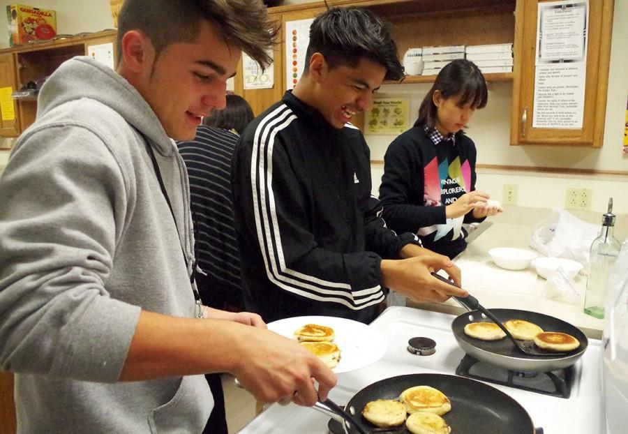 Jose Lopez, senior and Eduardo Hernandez, junior, making their pancakes