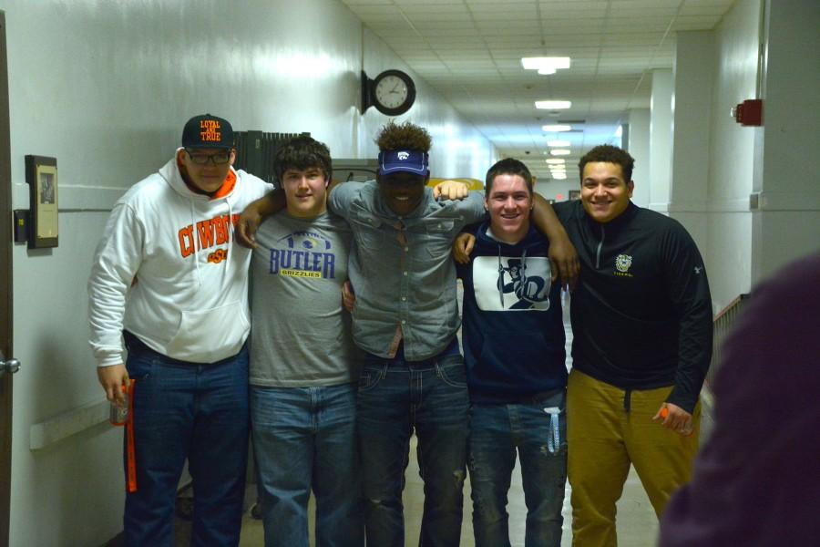 (From left to right) Teven Jenkins, Ryan Luna, Mike McCoy, Jacob Anderson, and Dakota Williams pose for camera during the National Signing Day event at Topeka High School.