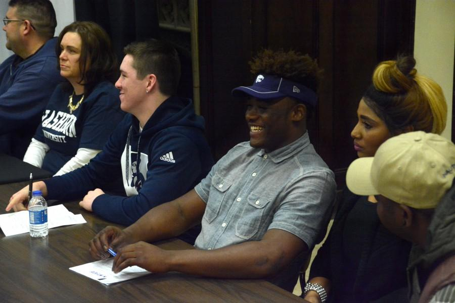 Mike McCoy, senior, cracks a smile before Topeka High footballs National Signing Day event. McCoy was rated the fifth best player in the state by Rivals and garnered attention from schools such as Arkansas, Oklahoma State, and Nebraska.