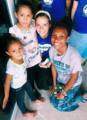 Jaide Ramirez-Jennings (right) and Tori Vaughn (left), juniors, posing with two girls they met on their trip.