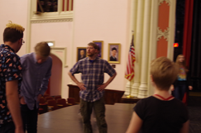 Benaiah Anderson, Stage Combat Director, works with students during a workshop