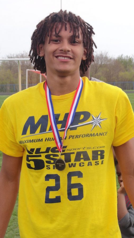 Justice Mitchell, junior, poses for a picture after being ranked as the best defensive back and seventh best overall player at the NUC Sports Five Star regional combine in Richton, Illinois this past Sunday. Mitchell plays defensive back for Topeka High.