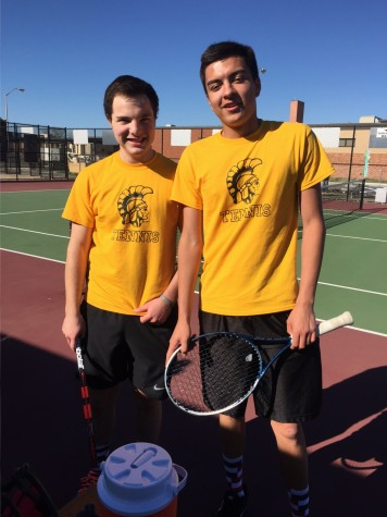 Chris Gernon (left), junior, and Matthew Gonzales, senior, (right) pose at a tennis meet at Salina Central.