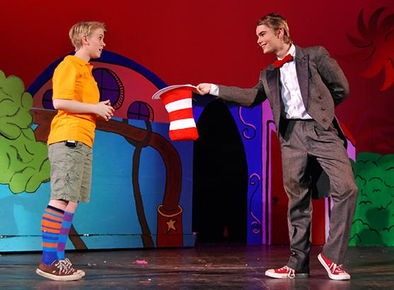 Tom Teeter, junior, offers Jordan Large, sophomore, his hat in this year's production of Seussical.