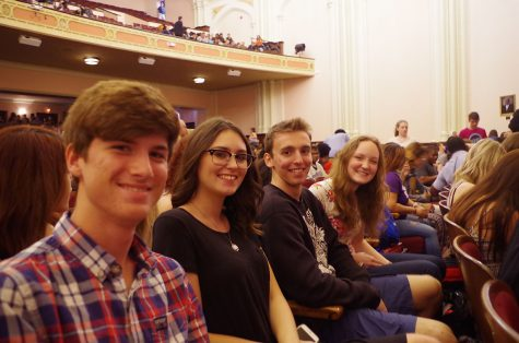 Exchange students sit in the auditorium before the senior recognition assembly. Photo by Erin Mumford