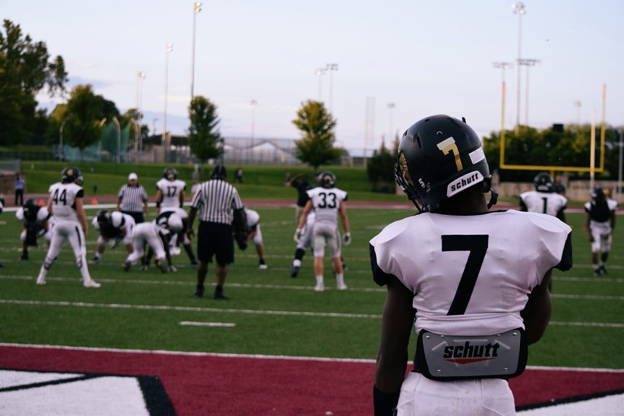 Jamien Berry, senior, stands in the endzone and looks on during the Black & Gold Scrimmage.