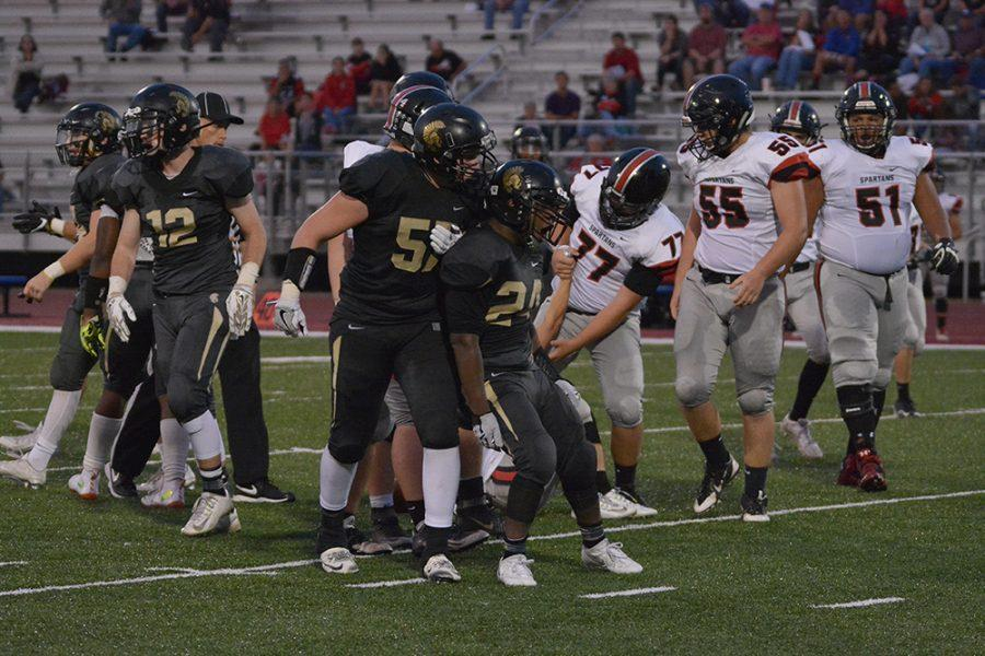 Senior lineman Billy Wagemaker (57) and senior nose tackle Bryce Pip Cooper (24) celebrate a sack. The Topeka High defense shut out Emporia en route to 49-0 win in their home opener.