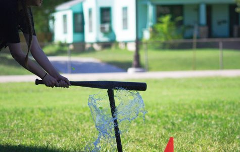 Jayna Thomspon, senior, hits a water balloon during the Clash of Clubs competition,
