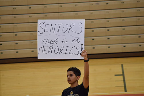 Adrian Horne, junior, holds up sign to commemorate  the seniors.