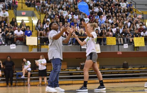 Alani Snook, senior, and David Smith, freshman, try to get the balloon in control.