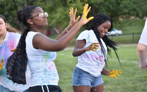 Keiana McMillian, sophomore, and Lavender Wilson, Junior, are eager to start off Color Chaos by getting paint on their hands.