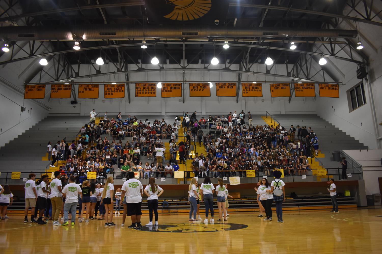 Link Crew leaders help freshman find seats.