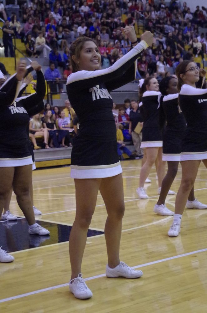 Roshele Reyes Bolanos, sophomore, dances during the cheer teams choreographed number.