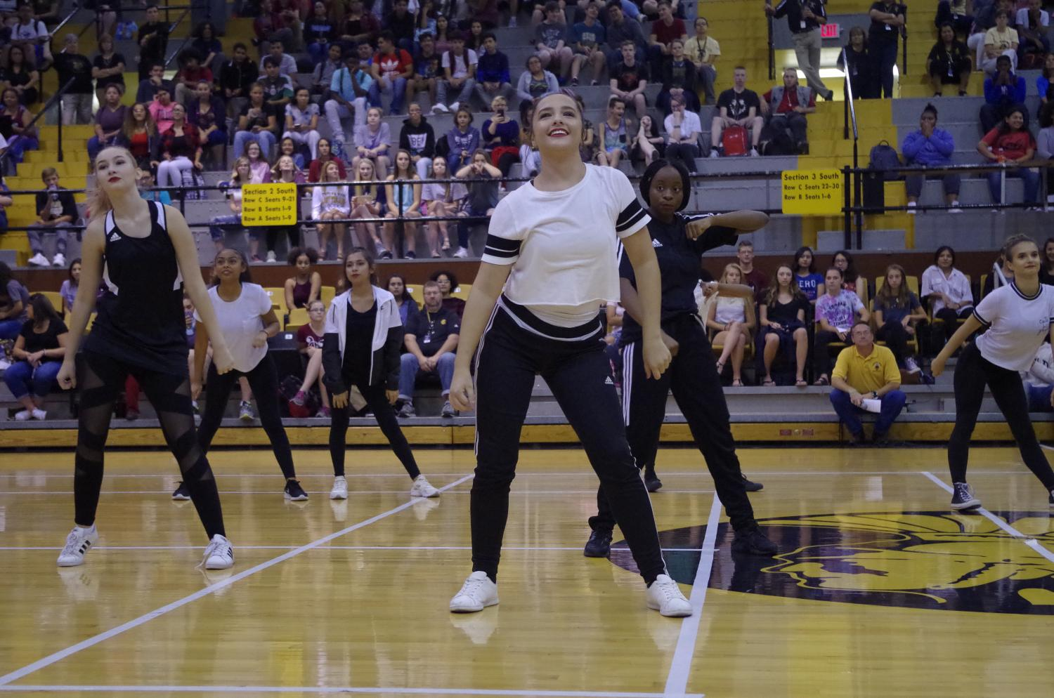The dance team performs at the pep rally.