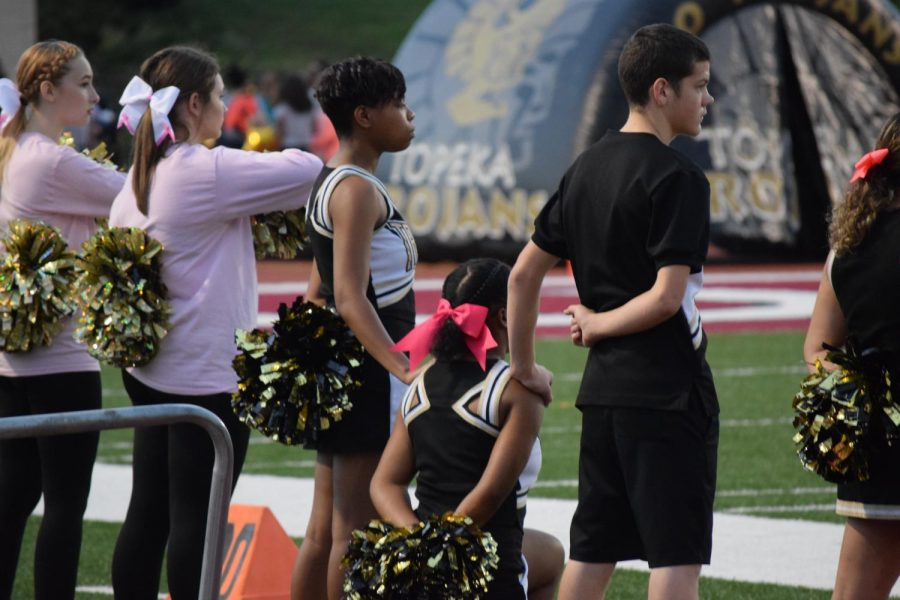 Student kneels during national anthem in act of protest