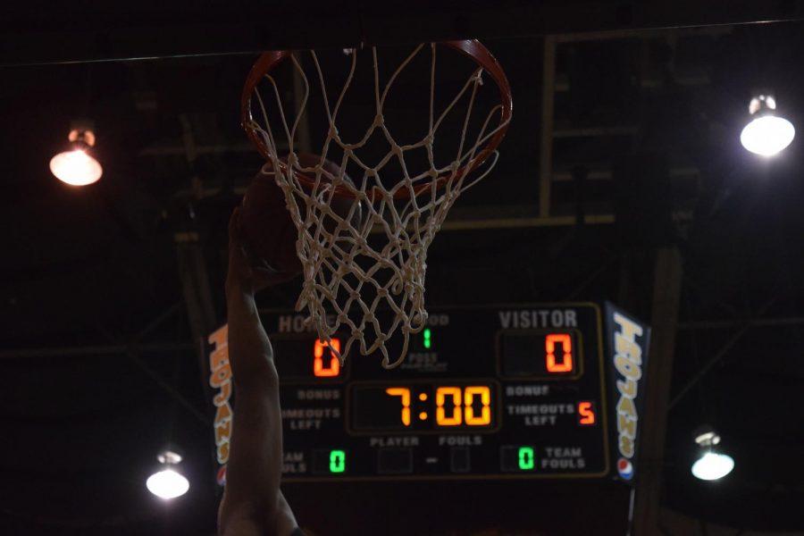 A player dunks the ball.