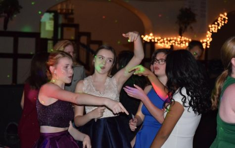 (Left to right) Sophomores, Katie Fitzgerald, Rose Pennington, Ann Beall, and Yadira Garcia dance at the 2016 Winter Semi-formal.