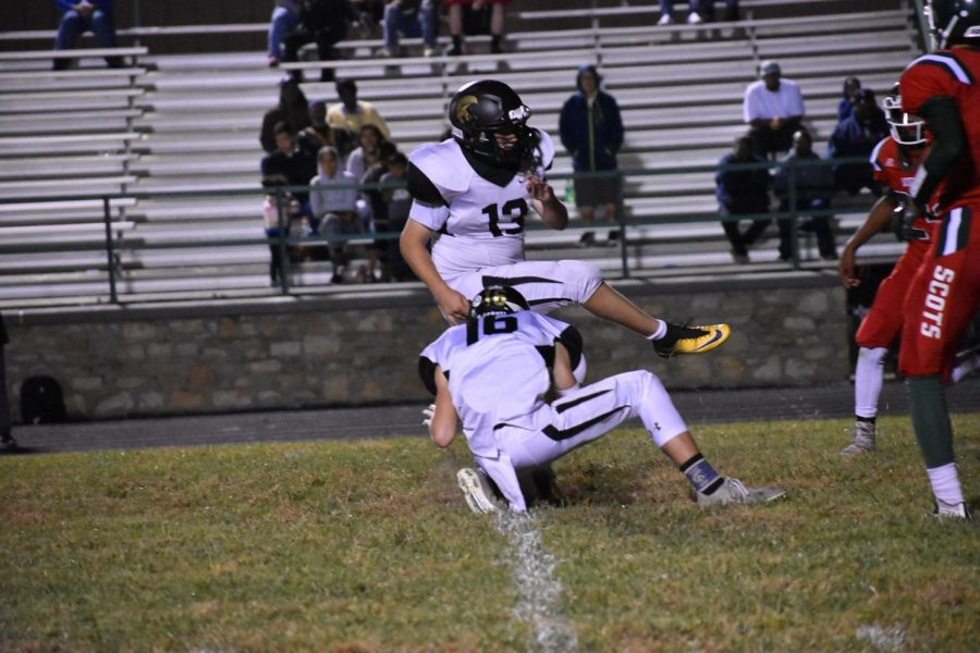 Tanner Scritchfield, junior, kicks his 50th field goal during the game against Highland Park High School.