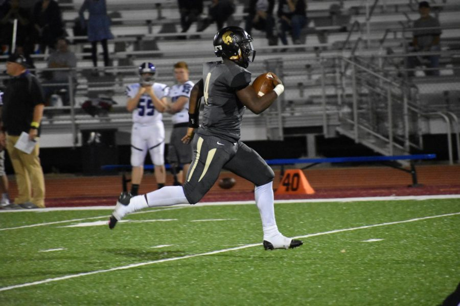 Jacquez Barksdale, senior, runs the ball down the field to score a touchdown against Topeka West.