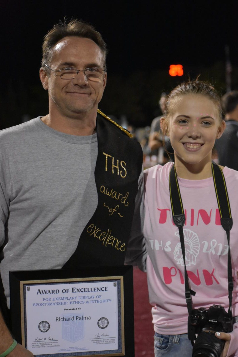 Teacher+Richard+Palma+smiles+at+the+camera+with+his+daughter%2C+Olivia+Palma%2C+after+receiving+the+Topeka+High+School+Award+of+Excellence.+
